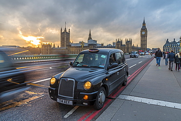 Sunset over a taxi and Big Ben on Westminster Bridge, London, England, United Kingdom, Europe