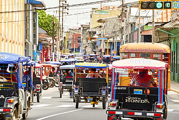 Mototaxis in a busy street in Iquitos, Peru, South America