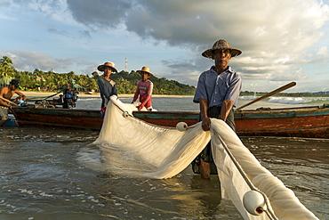 Fishermen at the beach in Ngwe Saung, Myanmar (Burma), Asia