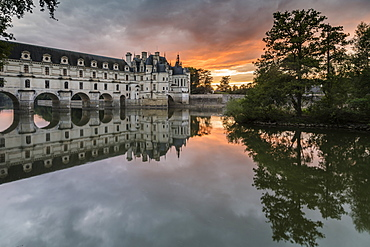 Chenonceau castle reflected in the Loire at sunset, UNESCO World Heritage Site, Chenonceaux, Indre-et-Loire, Centre, France, Europe