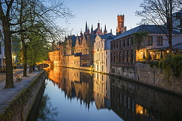 Houses and bridge reflected in the Groenerei canal at dusk, Bruges, West Flanders province, Flemish region, Belgium, Europe