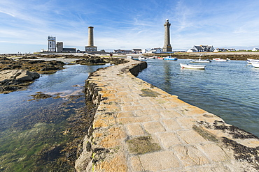 Lighthouses with pier and boats, Penmarch, Finistere, Brittany, France, Europe