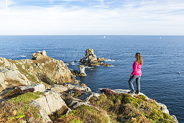 Woman on the cliffs of Van Point, Cleden-Cap-Sizun, Finistere, Brittany, France, Europe