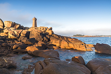 Morning light on Ploumanach lighthouse, Perros-Guirec, Cotes-d'Armor, Brittany, France, Europe