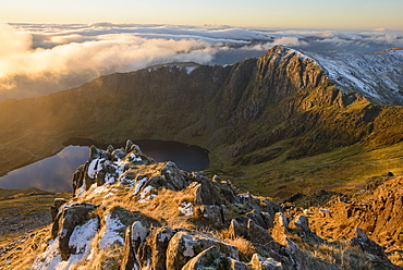 Morning light illuminates the top of Craig Cau during a cloud inversion, photographed from the top of Cadair Idris, Snowdonia, Wales, United Kingdom, Europe - 1255-21