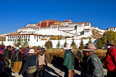 The Potala Palace, UNESCO World Heritage Site, with Tibetan Buddhist devotees, Lhasa, Tibet, China, Asia