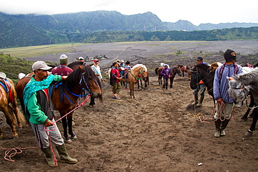 Horsemen on Mount Bromo volcano, Eastern Java, Indonesia, Southeast Asia, Asia