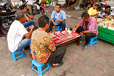 Men selling rings on the streets of Yogyakarta, Indonesia