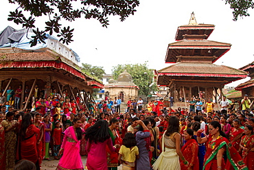 Women of Nepal celebrate Teej, a festival which blesses the men in their lives, Durbar Square, Kathmandu, Nepal, Asia