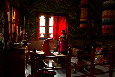 Buddhist monks from Bhutan make candles in their Bhutan Temple in Bodh Gaya, Bihar, India, Asia