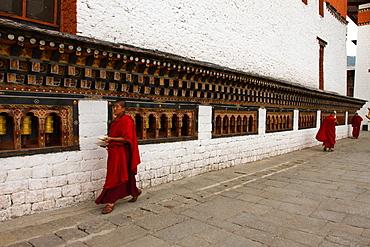 Monks and prayer wheels, Tashi Chho Dzong Fortress, Thimpu, Bhutan, Asia