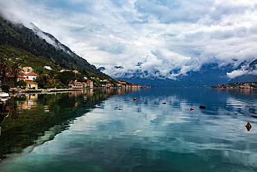 The village of Muo which faces Kotor across the bay, the mountains covered in low cloud, Montenegro, Europe