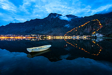 The Old Town (stari grad) and fortress of Kotor reflected in Kotor Bay, UNESCO World Heritage Site, Montenegro, Europe