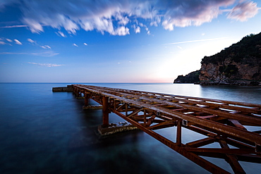 A long exposure during sunset of an old jetty on the beach of Budva's old town (stari grad), Montenegro, Europe