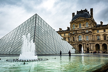 The large pyramid sits in the main courtyard and is the main entrance to the Louvre Museum, Paris, France, Europe