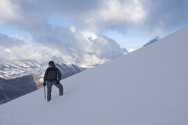 Hiker in winter, Motette, Umbria, Italy, Europe