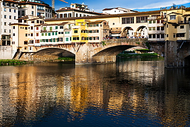 Ponte Vecchio reflected in the Arno River, Florence, UNESCO World Heritage Site, Tuscany, Italy, Europe