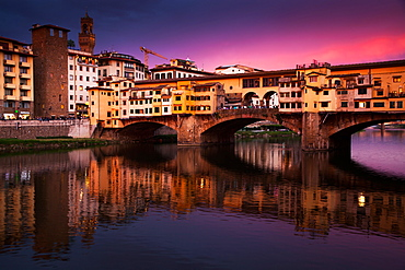 Ponte Vecchio at sunset reflected in the River Arno, Florence, UNESCO World Heritage Site, Tuscany, Italy, Europe