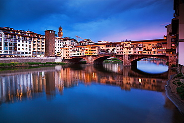 Ponte Vecchio at night reflected in the River Arno, Florence, UNESCO World Heritage Site, Tuscany, Italy, Europe