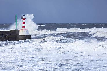Stormy seas as spring tides coincide with the so called Beast from the East at Amble, Northumberland, England, United Kingdom, Europe