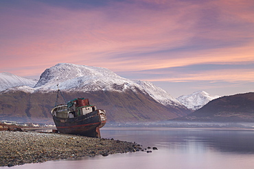 Fishing boat and snow capped Ben Nevis from the shore of Loch Linnhe at sunset, Corpach, near Fort William, Highlands, Scotland, United Kingdom, Europe