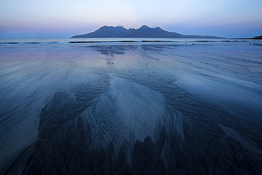 Pre-sunrise colours and view to the Isle of Rum from the beach at Laig Bay, Isle of Eigg, Small Isles, Highlands, Scotland, United Kingdom, Europe
