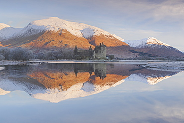 The ruins of Kilchurn Castle seen across Loch Awe at sunrise in winter, Kilchurn Bay, Loch Awe, Argyll and Bute, Highlands, Scotland, United Kingdom, Europe