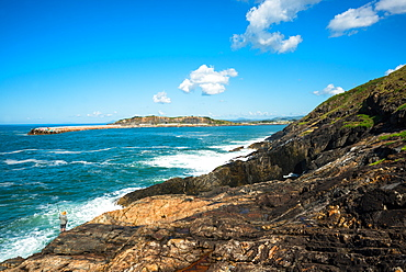 A lone fisherman sea fishing on Muttonbird Island, Coffs Harbour, New South Wales, Australia, Pacific