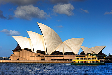 Ferry goes past the Sydney Opera House, UNESCO World Heritage Site, at Golden hour, Sydney, New South Wales, Australia, Pacific