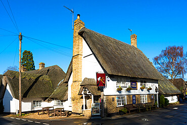 Traditional village pub Axe and Compass with Thatched roof at Hemingford Abbots, Cambridgeshire, England, UK.