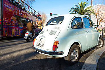 Rome traffic with classic Fiat 500 car, scooter and tourist bus, seen on city street, Rome, Lazio, Italy, Europe