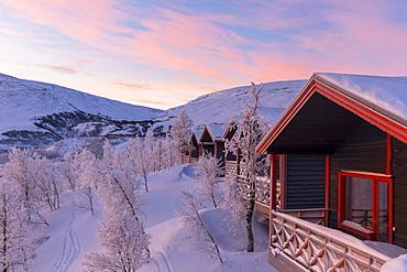 Sunrise at the picturesque Bjorkliden houses, Bjorkliden, Norbottens Ian, Sweden, Scandinavia, Europe