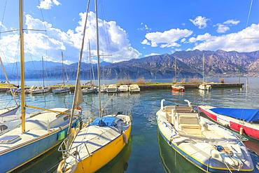 Moored sailboats at tourist port of Malcesine, Lake Garda, Verona province, Veneto, Italian Lakes, Italy, Europe