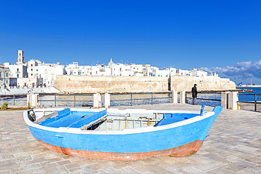 Old boat with the Italian old town in the background, Monopoli, Apulia, Italy, Europe