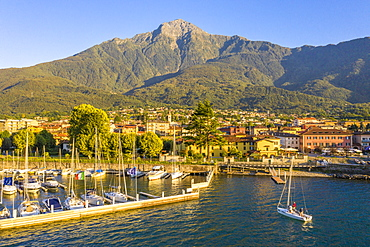 Sailing boat arrived at the port of Colico village, Lake Como, Lombardy, Italian Lakes, Italy, Europe