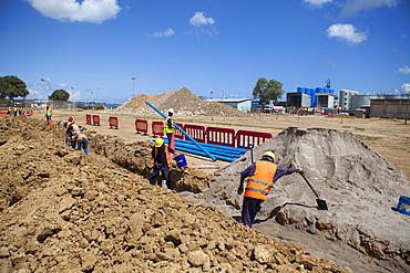 Workmen dig a trench and install a new pipeline, Mtwara, Tanzania, East Africa, Africa