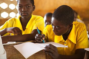 Students studying in classroom at a Junior High School, Northern Ghana, West Africa, Africa