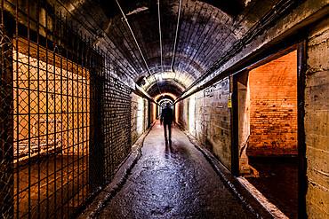 A tourist walking through The Underground German Hospital in Guernsey