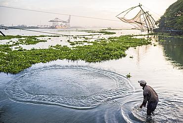 Traditional Chinese fishing nets at sunrise, Fort Kochi (Cochin), Kerala, India, Asia