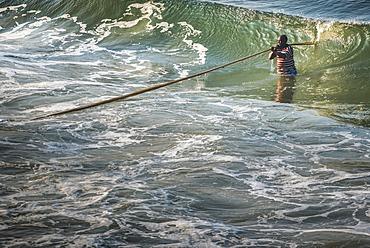 Fisherman at Kappil Beach, Varkala, Kerala, India, Asia