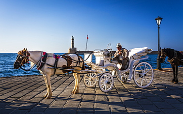 A horse and cart for city tours, at the Venetian era harbour, at the Mediterranean port of Chania (Canea), Crete, Greek Islands, Greece, Europe