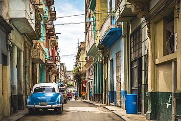 Blue vintage car parked on old colourful street in La Habana, Havana, Cuba, West Indies, Caribbean, Central America