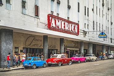 Old vintage cars parked outside Teatro America, La Habana (Havana), Cuba, West Indies, Caribbean, Central America