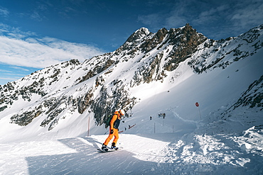 Snowboarder going down the slope at La Plagne ski resort, Tarentaise, Savoy, French Alps, France, Europe