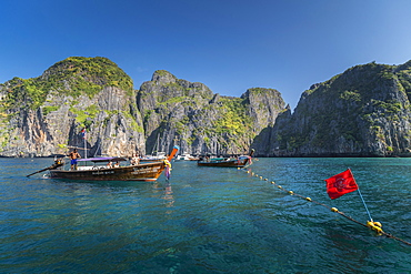 Maya Bay The Beach with long-tail boats and tourists, Phi Phi Lay Island, Krabi Province, Thailand, Southeast Asia, Asia