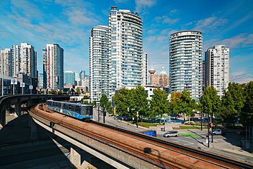 View of Sky Train and urban office blocks and apartments, Vancouver, British Columbia, Canada, North America