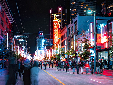 People having fun on Friday night on Granville Street, Orpheum Theatre visible in the background, Vancouver, British Columbia, Canada, North America