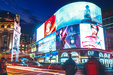 Traffic trails and advertisements at night near Piccadilly Circus, London, England, United Kingdom, Europe