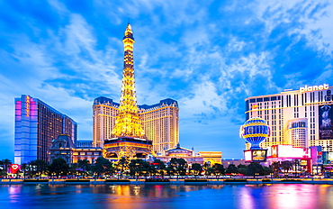 View of Eifel Tower of the Paris Hotel and Casino, The Strip at dusk, Las Vegas Boulevard, Las Vegas, Nevada, United States of America, North America