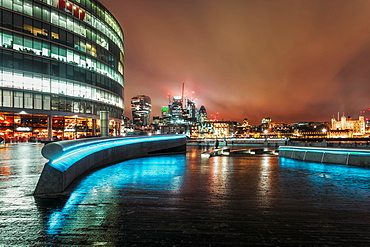 View of London skyline and Tower of London visible in background at night, Southwark, London, England, United Kingdom, Europe